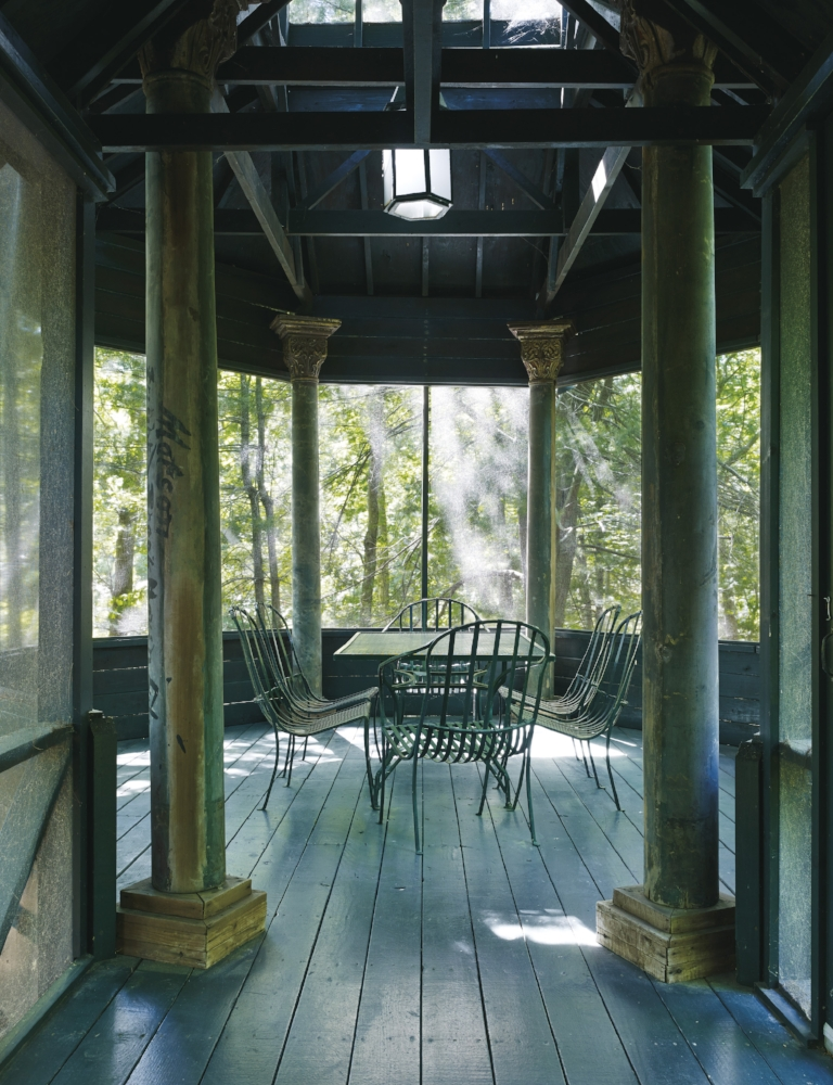 view of the screened-in porch of the guest house.