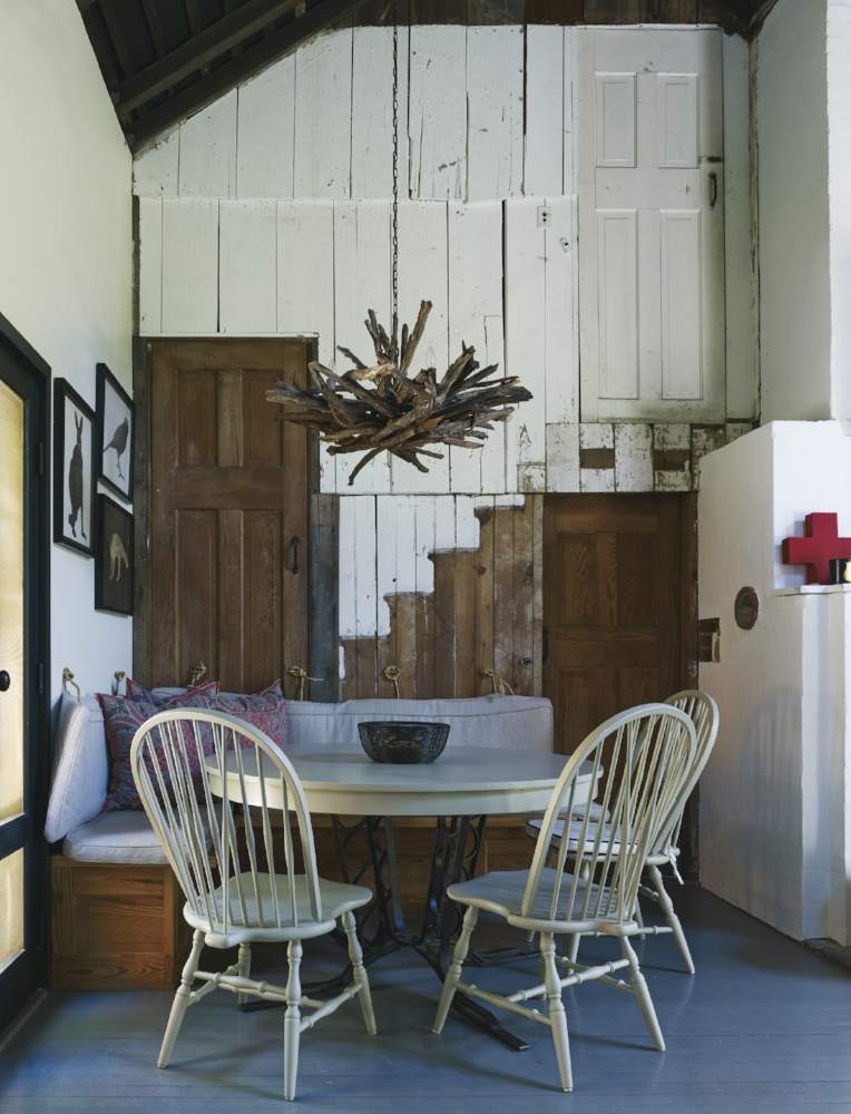 In the kitchen, Wright left traces of the original staircase to the hayloft. The cushions are covered in fabric from Ralph Lauren Home; the twig chandelier is from a flea market in Paris.
