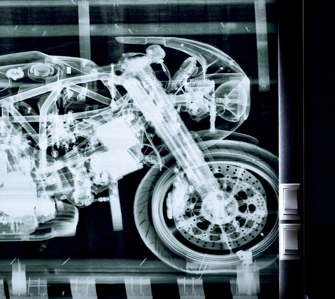 An X-ray of a limited-edition Ducati M900, a gift from a client, hangs in Siegl's workshop.
