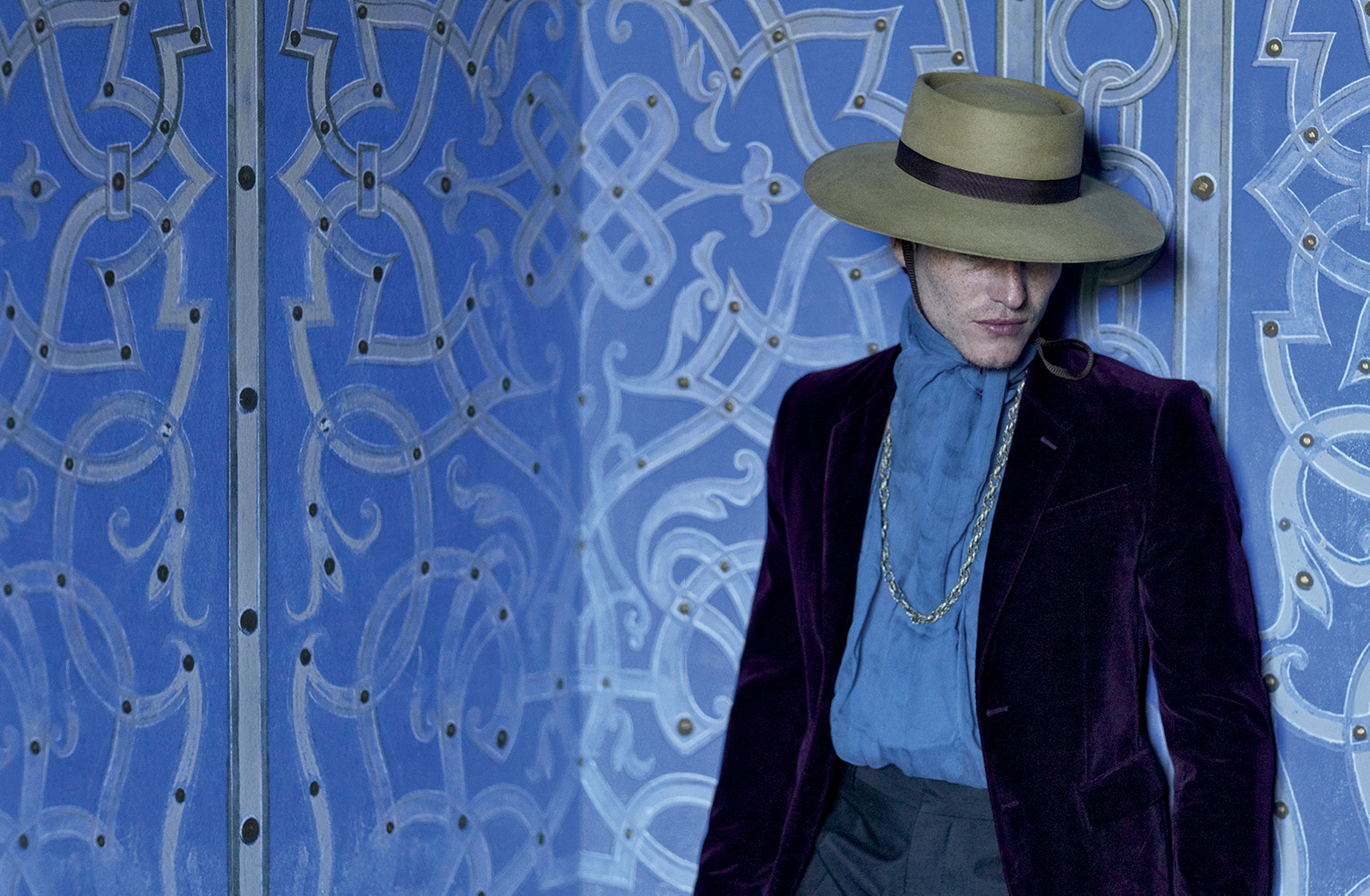 Dark amethyst tailored velvet jacket BURBERRY PRORSUM, dark green large straight-cut trousers in brushed cotton LANVIN, silk foulard, gaucho hat and moroccan necklace MELET MERCANTILE