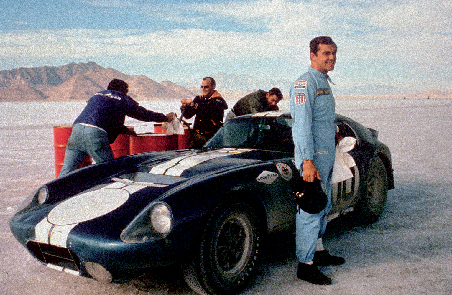 driver Craig Breedlove takes a fuel break at the Bonneville Salt Flats in Utah, where the car set twenty-three speed and endurance records in 1965.