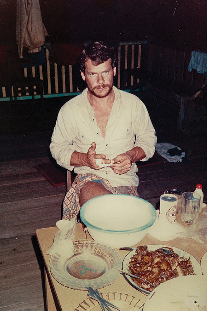 JL in a longhouse on the East Coast of Kalimantan (Indonesian Borneo) after the first coast-to-coast traverse of the island, third largest on earth.