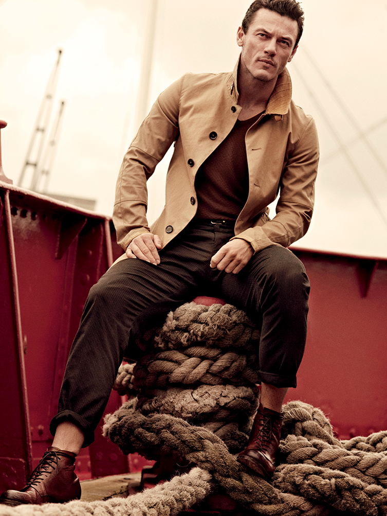 Canvas and leather coat Belstaff, Cashmere knit t-shirt Giorgio Armani, Wool pleated pants and calfskin belt Dolce & Gabbana, Calf boots Esquivel Shoes