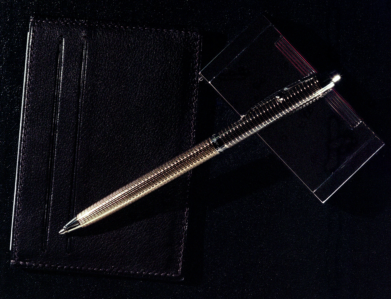 Leather cardholder Hermès, Silver pen Fischer Space Pens, Silver lighter Prometheus