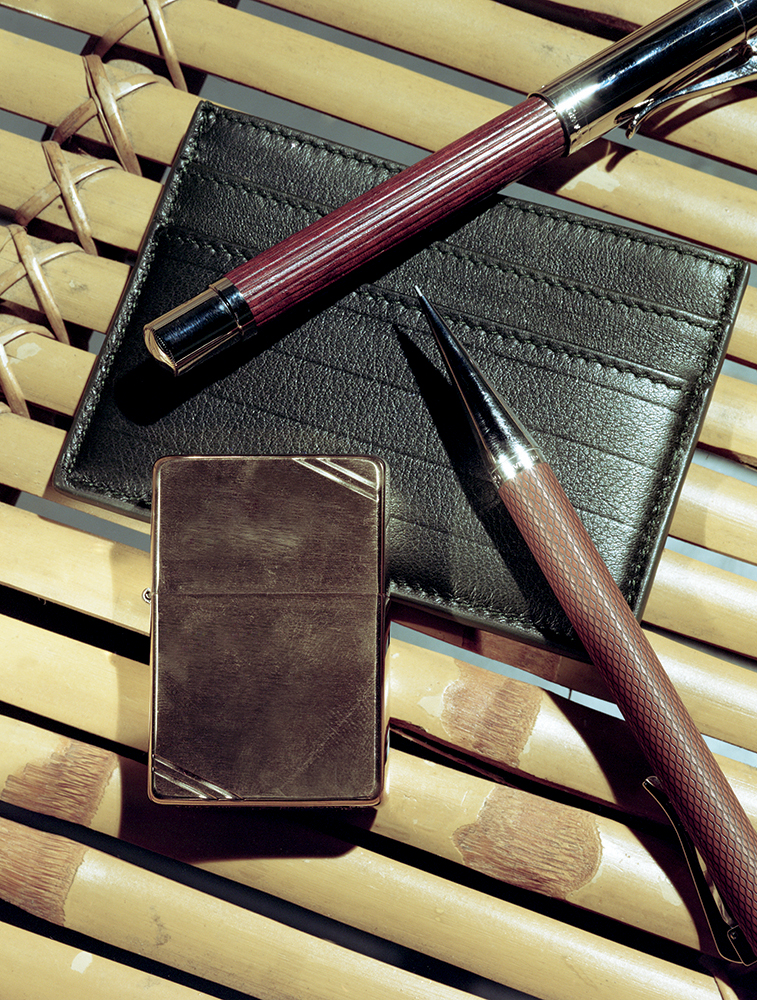 Wooden and gold pen and pencil Faber-Castell, Gold plated lighter Zippo, Leather cardholder Dior Homme