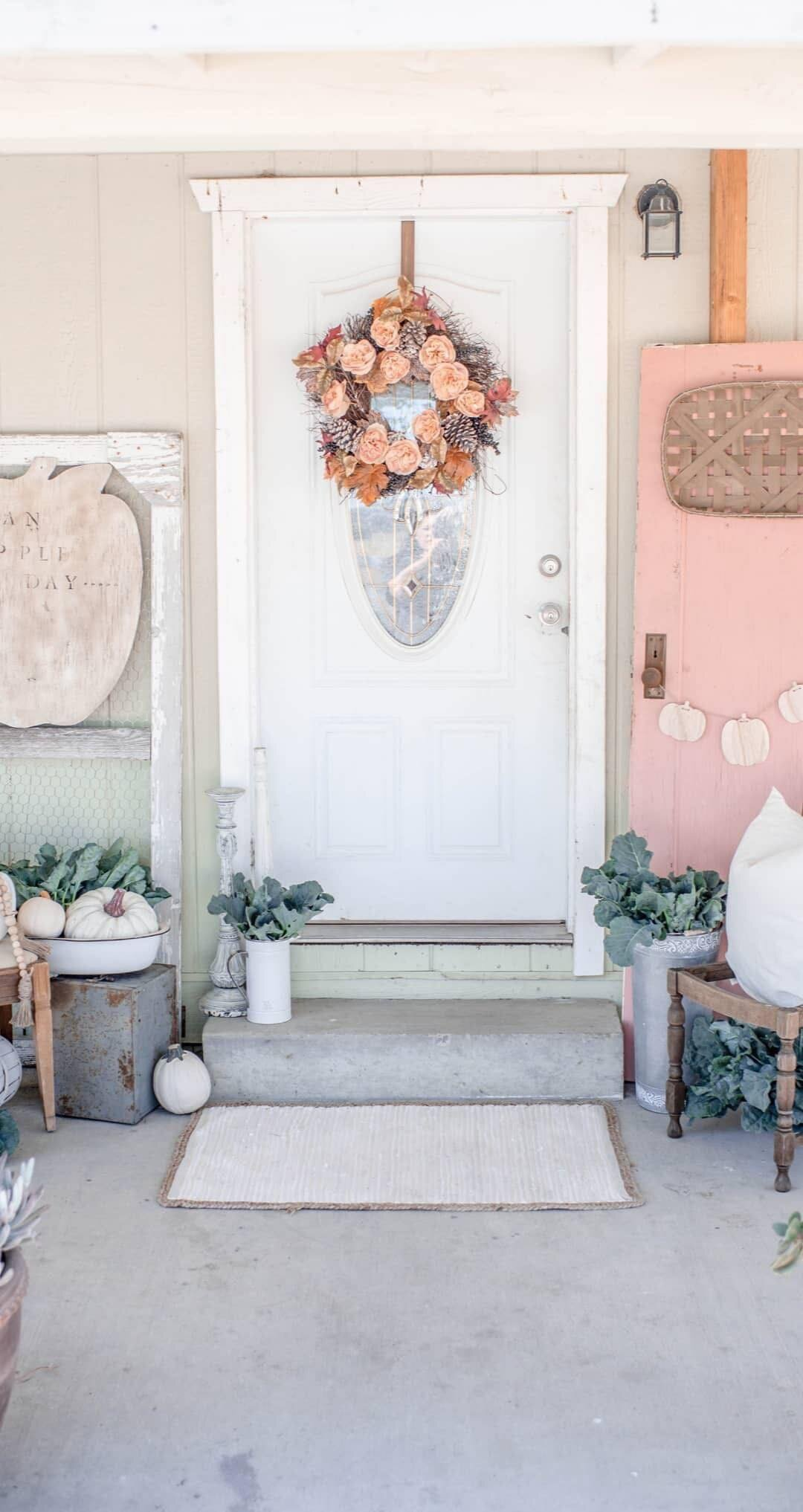 Cory over at Hudson Farmhouse is sharing her pink fall front porch decor. To get more pink fall feels, check out her blog  here