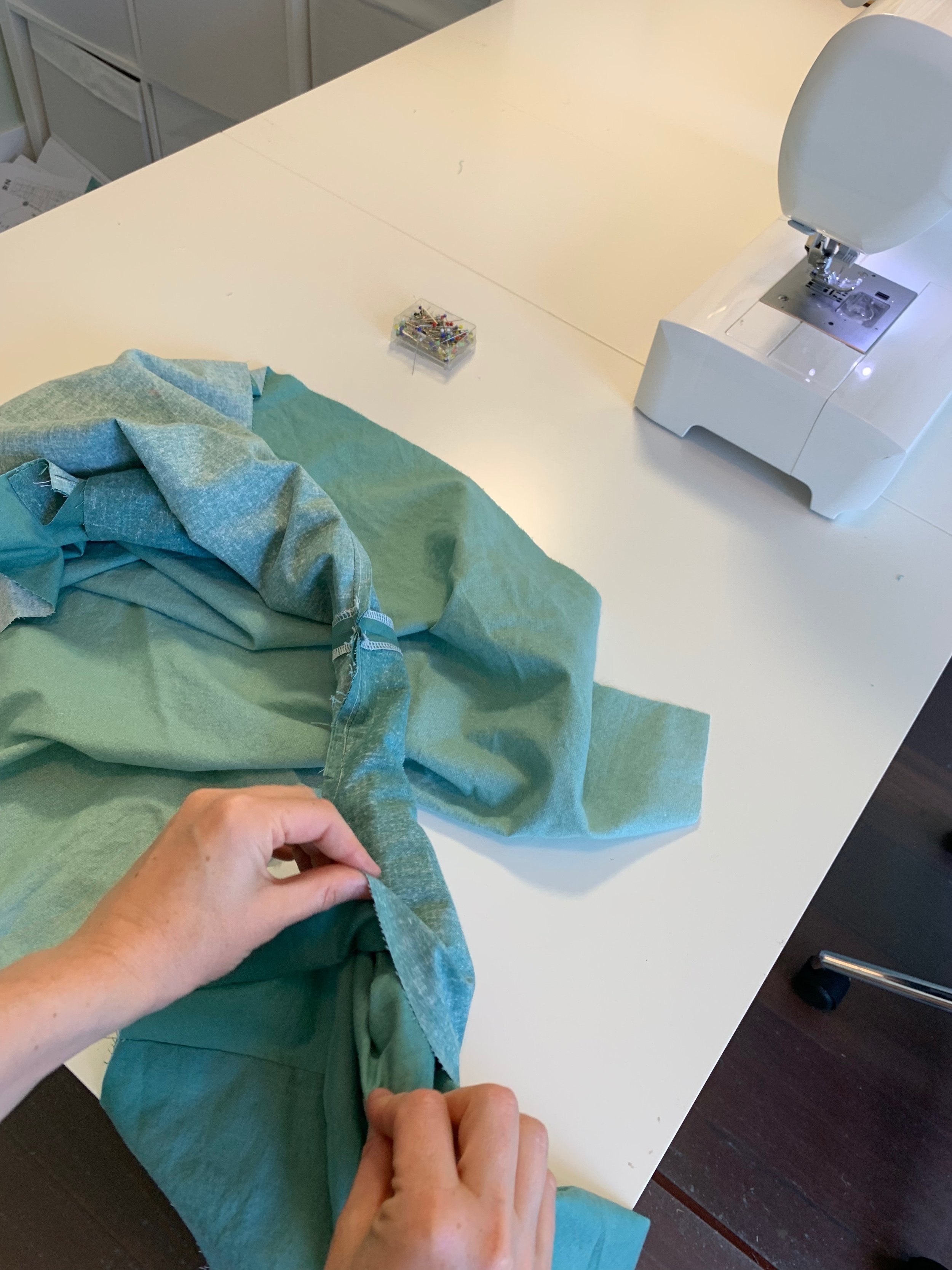 "Pulling the facing and bodice through ""burrito"" to right side (shown here on the Version A dress)"