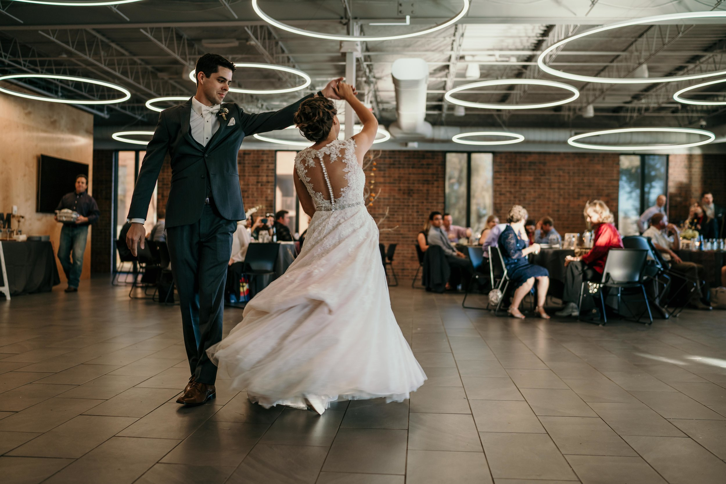 denver wedding first dance at colorado professional fire fighters event center