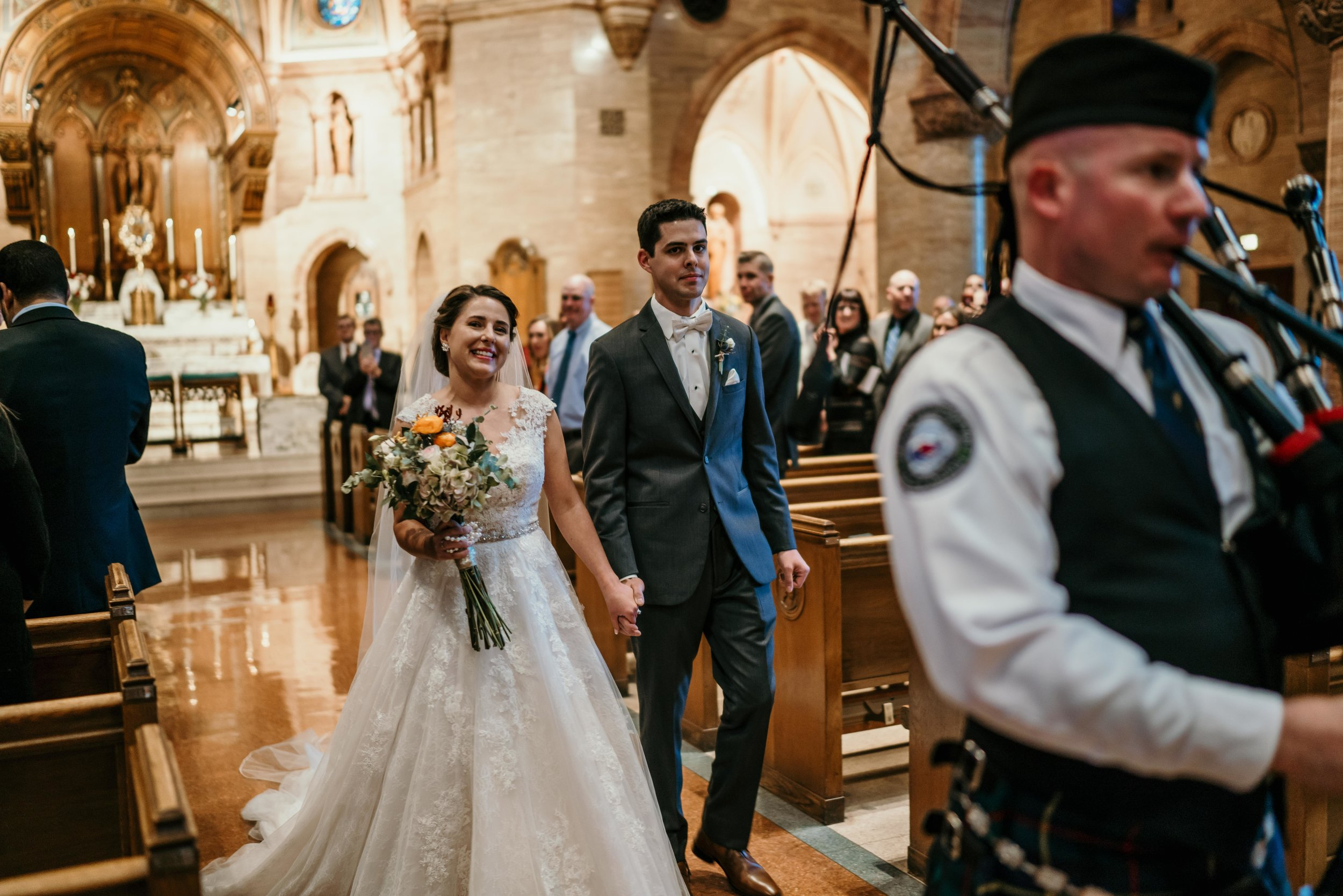 denver wedding at holy ghost bride and groom with bag pipes