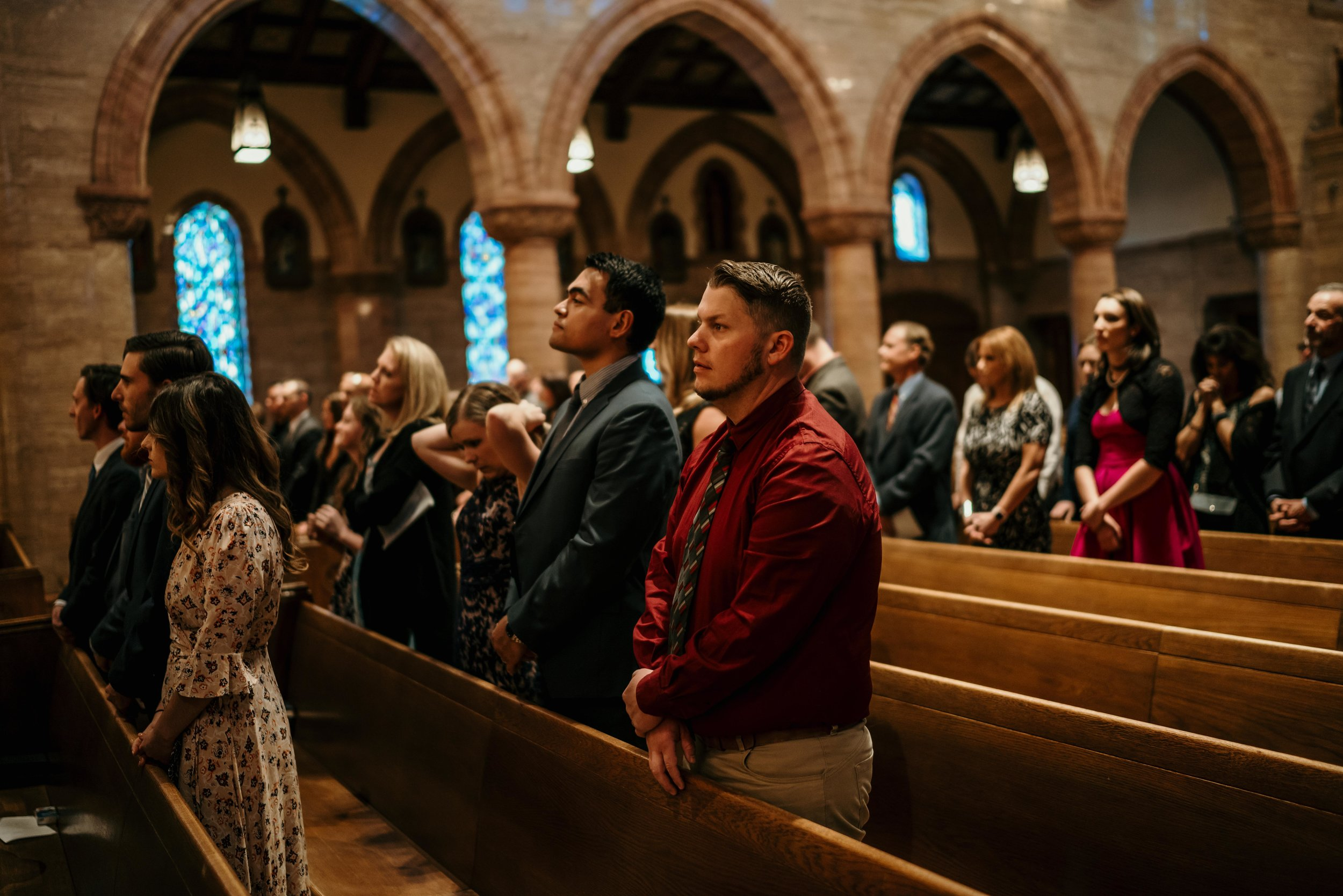 denver wedding at holy ghost church guests in pews