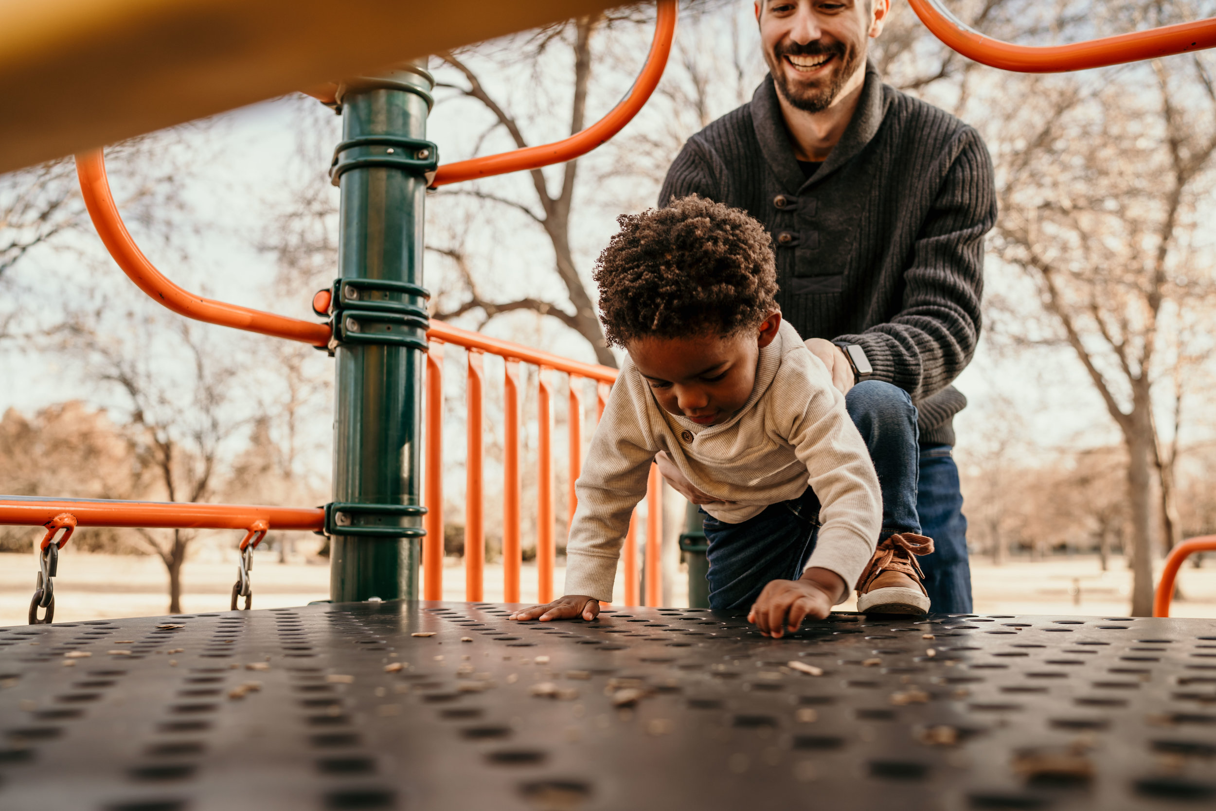 denver family photographers at city park kid on playground