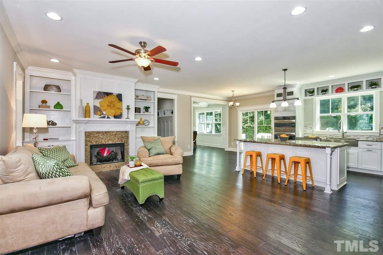 Beautiful living room in Apex, NC gets occupied staging services by Ellie Mayes