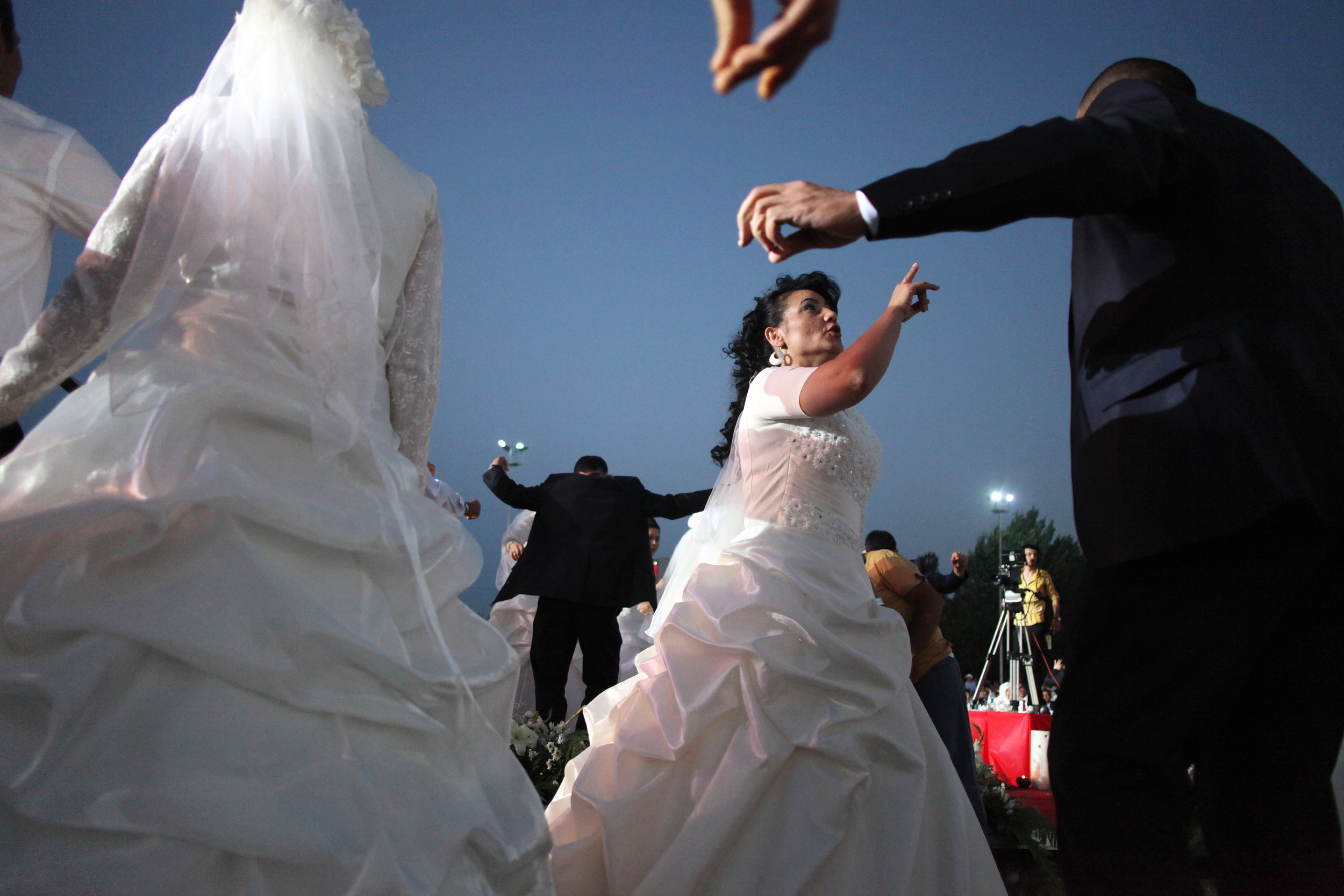 Couples dance during a wedding festival which the Ankara Buyuksehir Municipality organizes annually to help low-income families on June 29, 2013 in Ankara, Turkey. This year 213 couples participated in this community wedding.