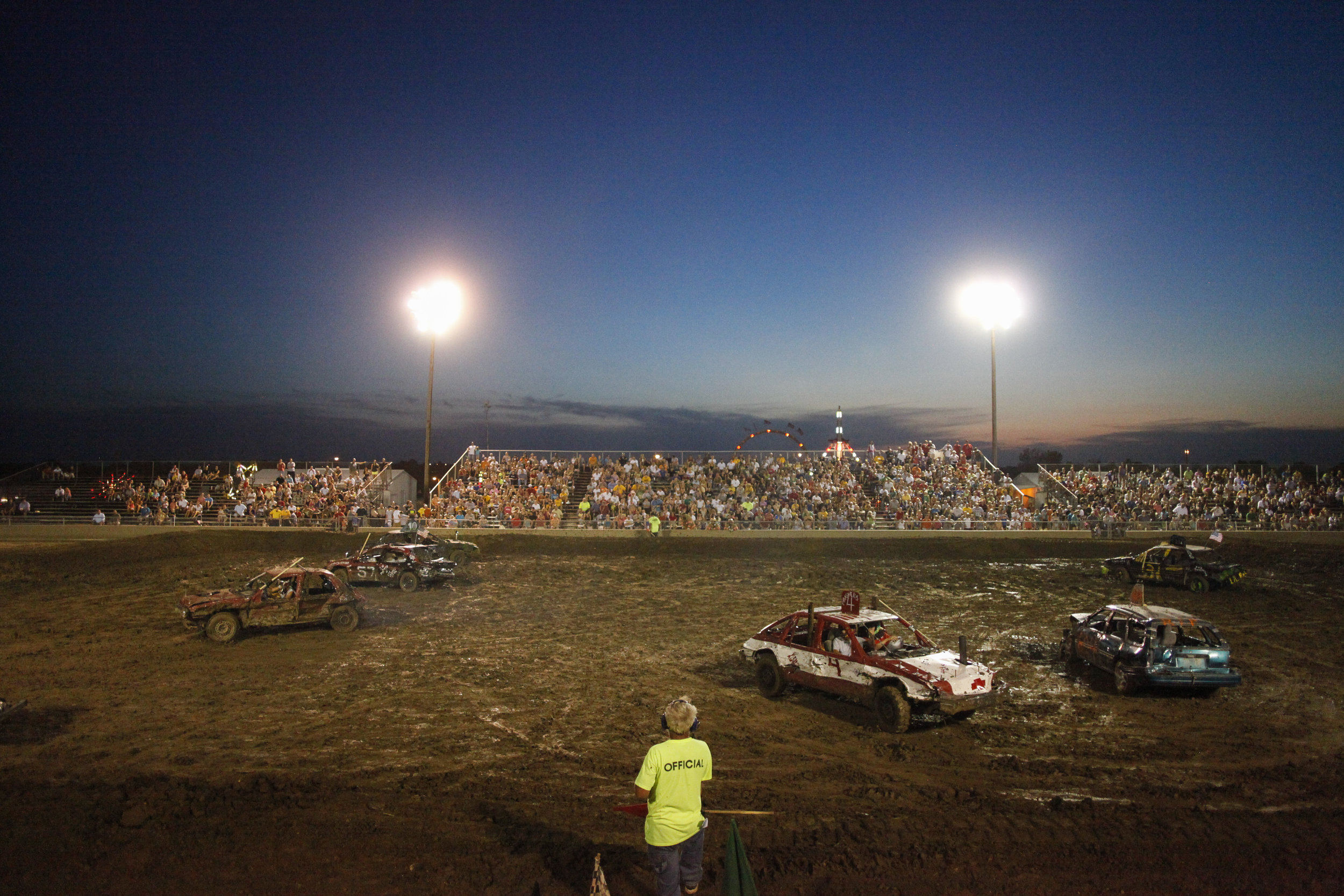 Demolition Derby participants wait to restart the race after a short break Wednesday evening, July 25, 2012 at Boone County Fairgrounds.