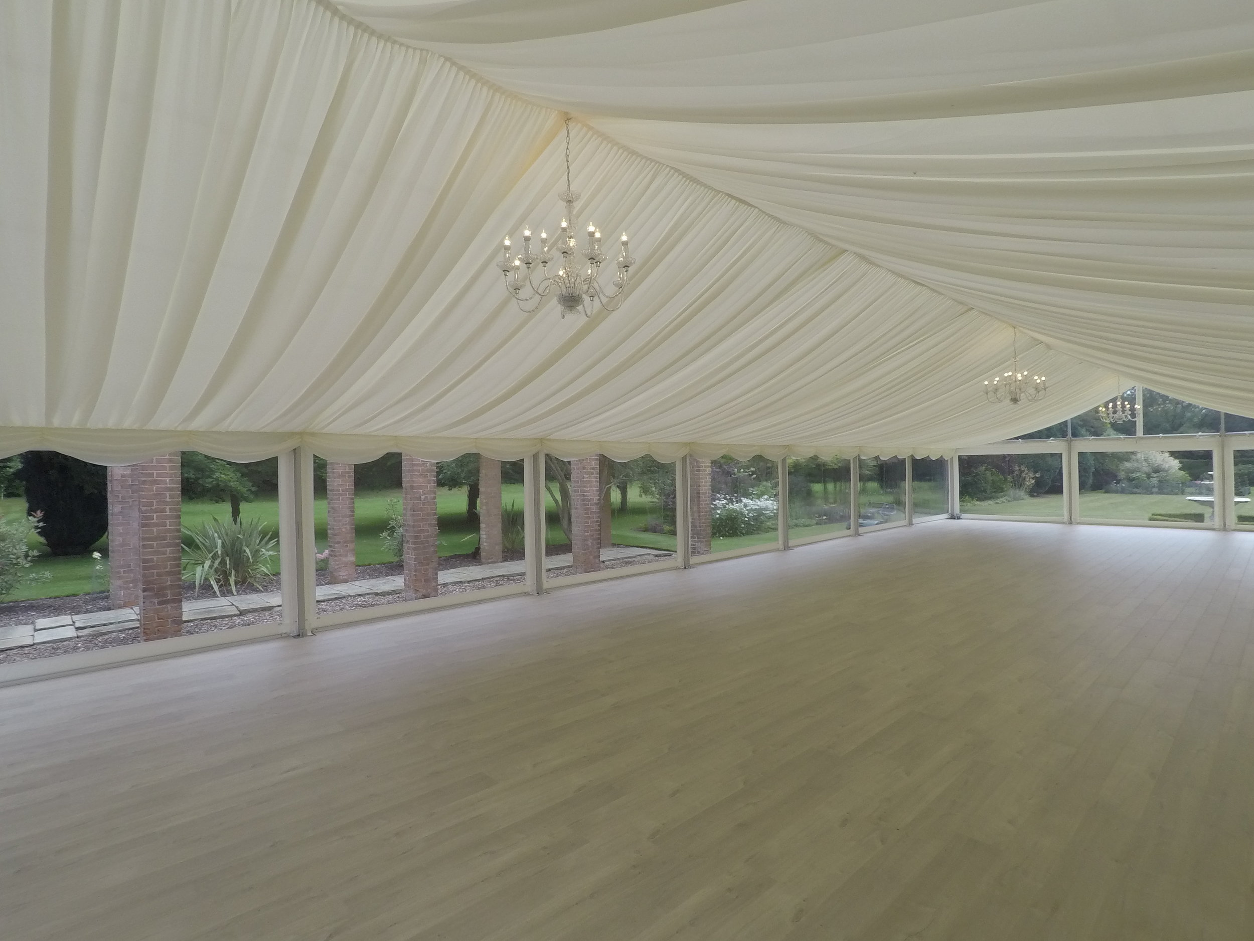 Pleated Linings - Pleated linings are what we provide as standard linings and these are currently available in ivory or white. These are what dress the ceiling and walls of the interior of the marquee, covering the internal metal work and PVC.