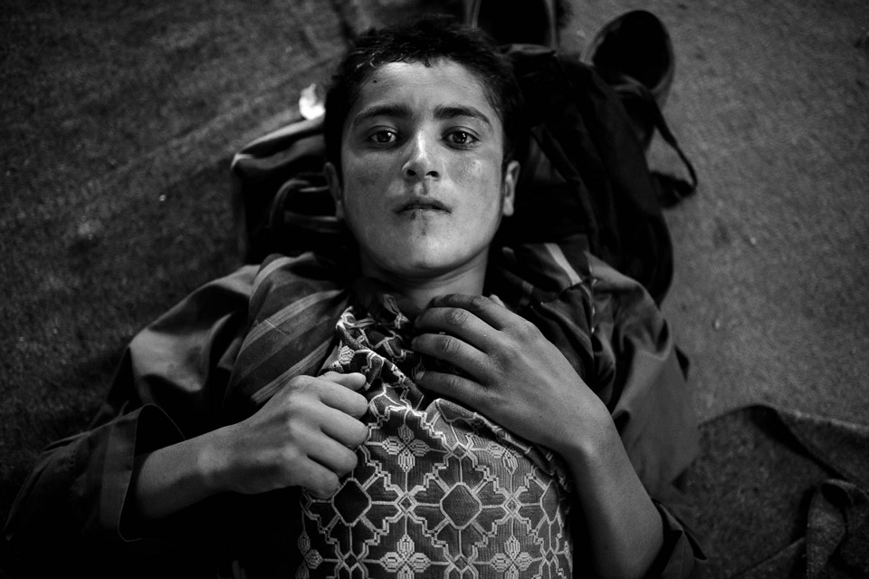 Mohammad Asef, 17, from Mazar Sharif, Afghanistan. Refugees detained by Iranian border police are held in a camp lacking proper hygiene. There is not enough food and clean water. Iranian police are fighting against human trafficking although there are accusations that they also assist smugglers. August 2017.
