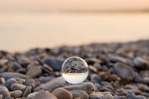 Glass dome reflecting ocean. Astrology. Universe