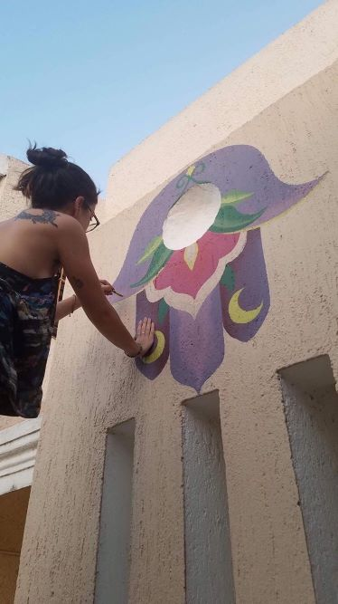 Sylvia Annelise Hecht painting an image at an Airbnb in Mérida , Yucatan, Mexico.