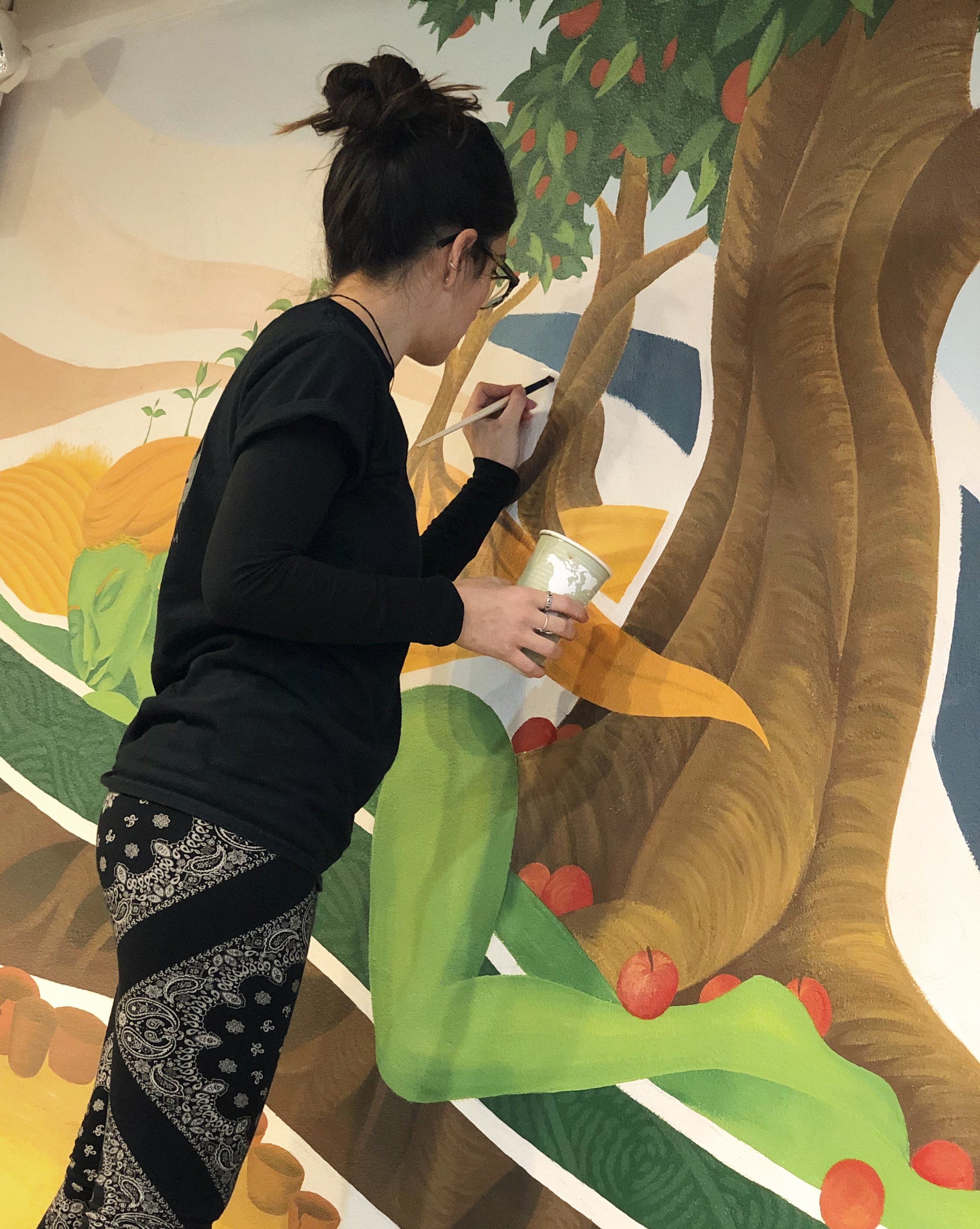 Sylvia Annelise Hecht painting a mural in her hometown, Madison, Wisconsin.