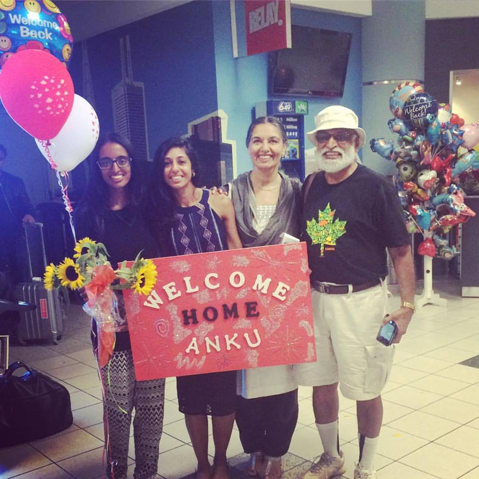Ankita being greeted by her family upon her return back to Canada.