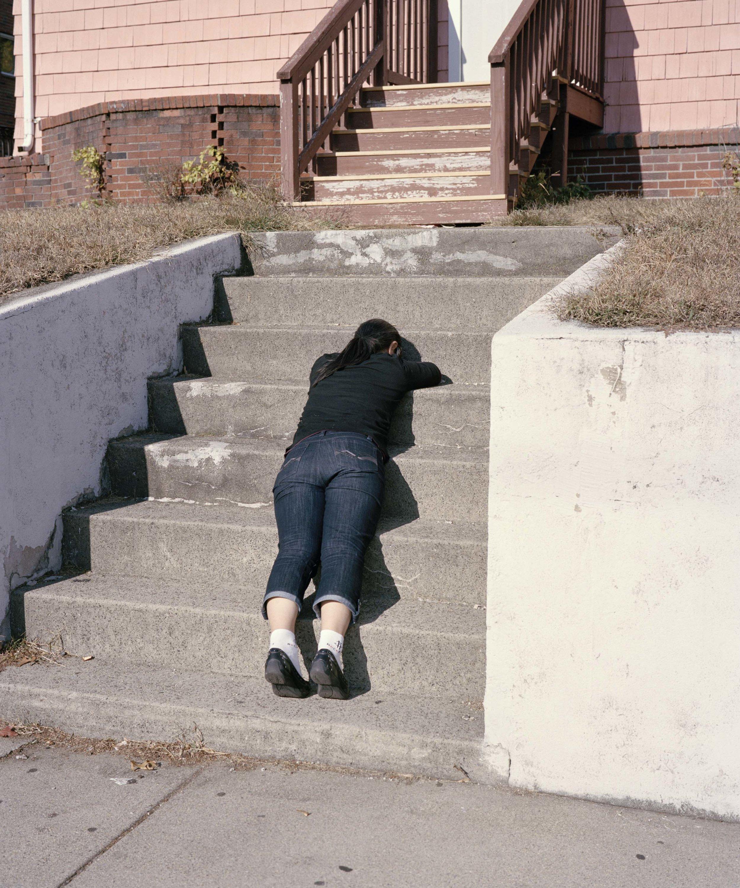 Woman Laying on Stairs, near Boston, MA, 2013