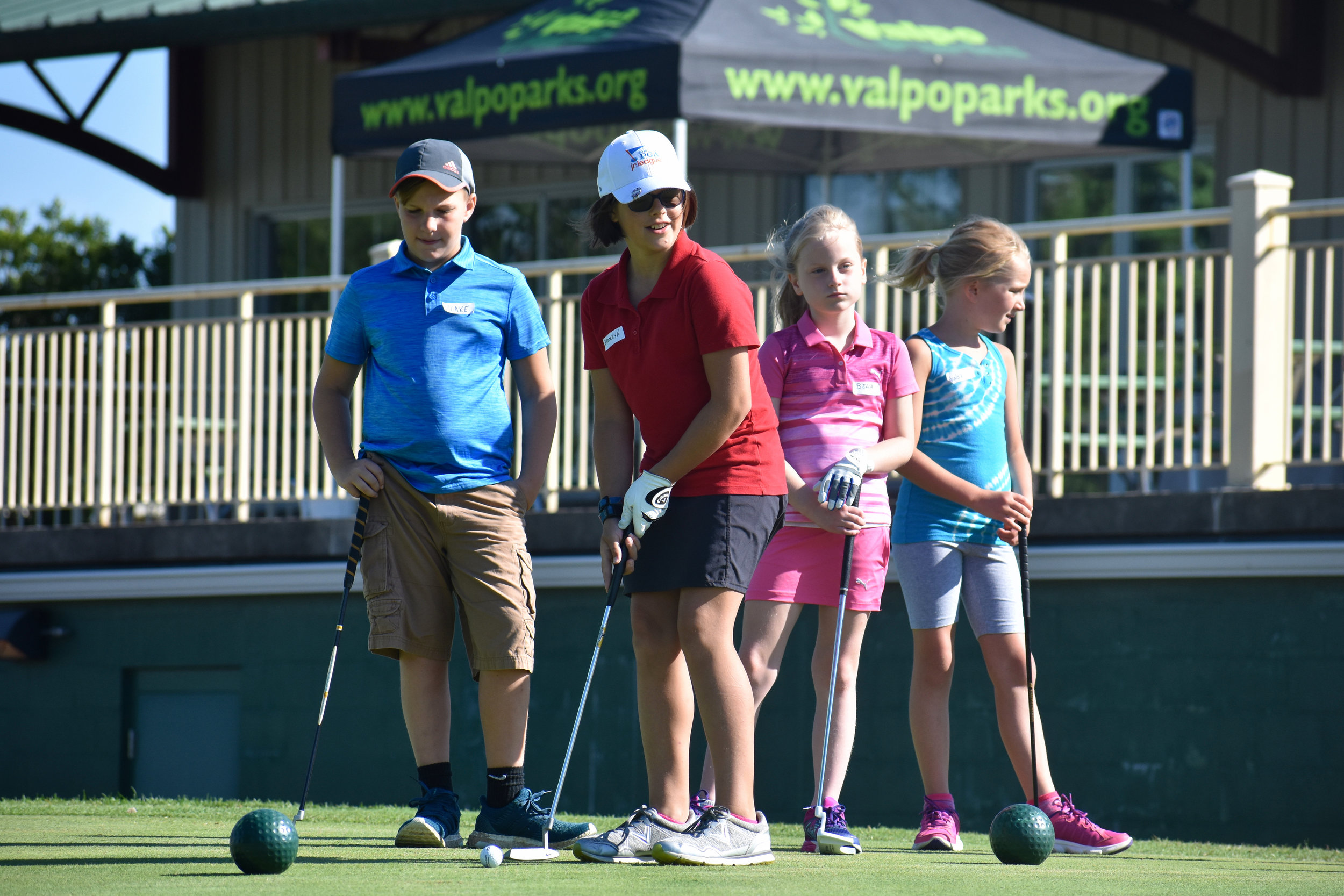young lady putting.jpg