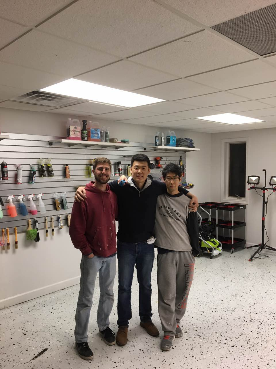 Colin, Yifei and Difu after a night spent building Auto Club Detailing's facility
