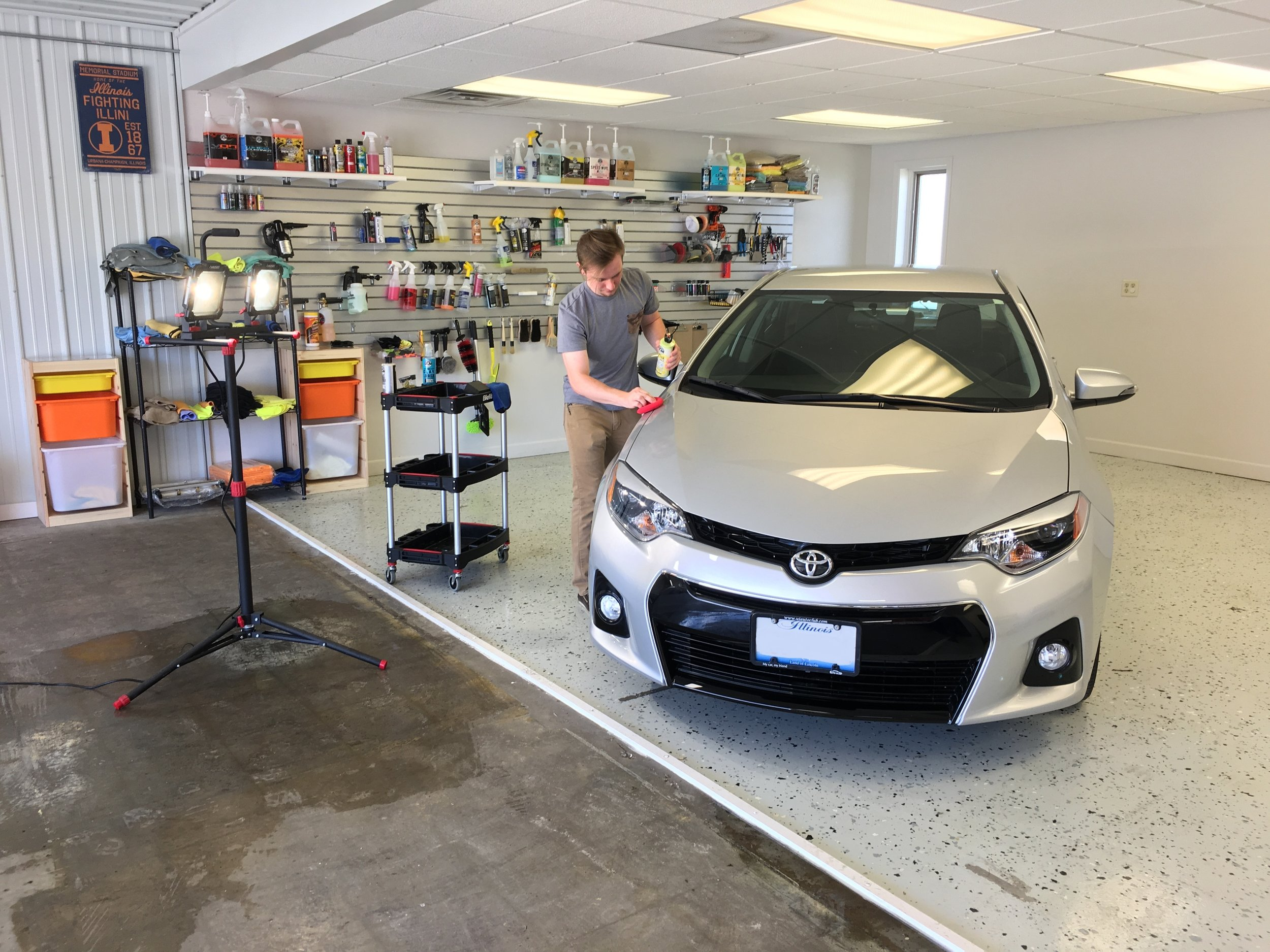 Kyle puts the finishing touches on a customer car