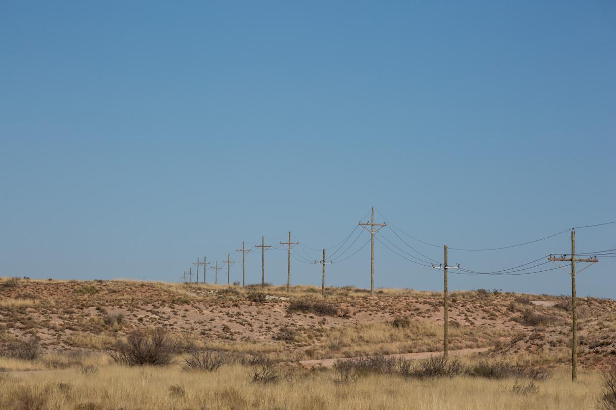 powerlines in scrubby landscape