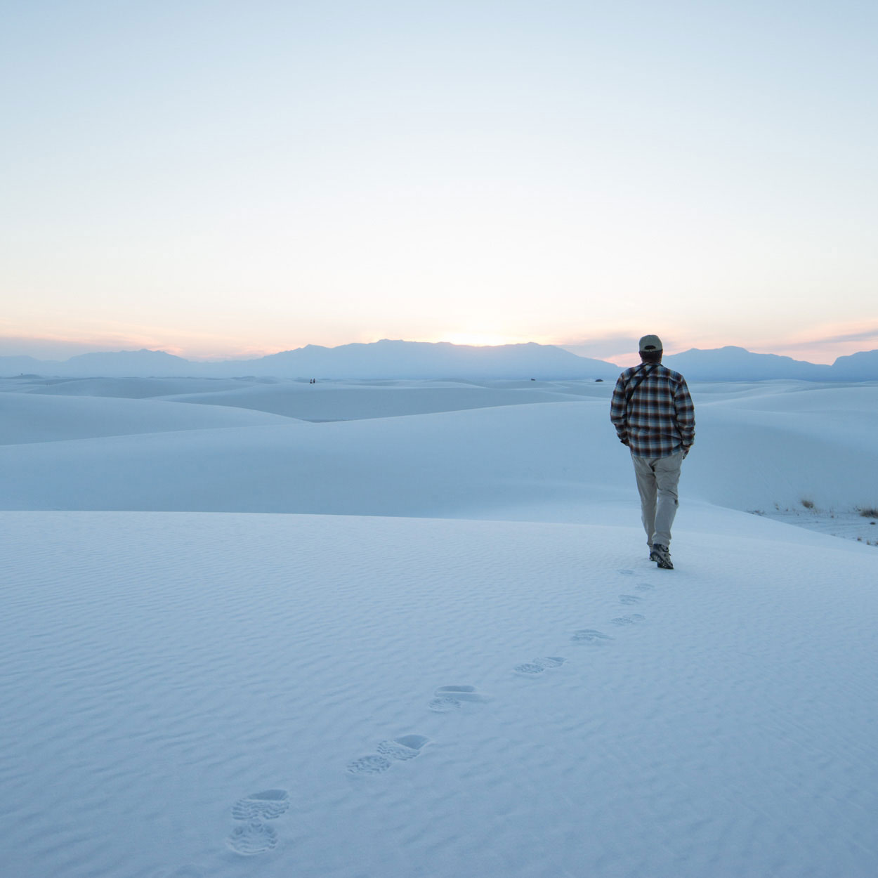 walking into the white sand dunes