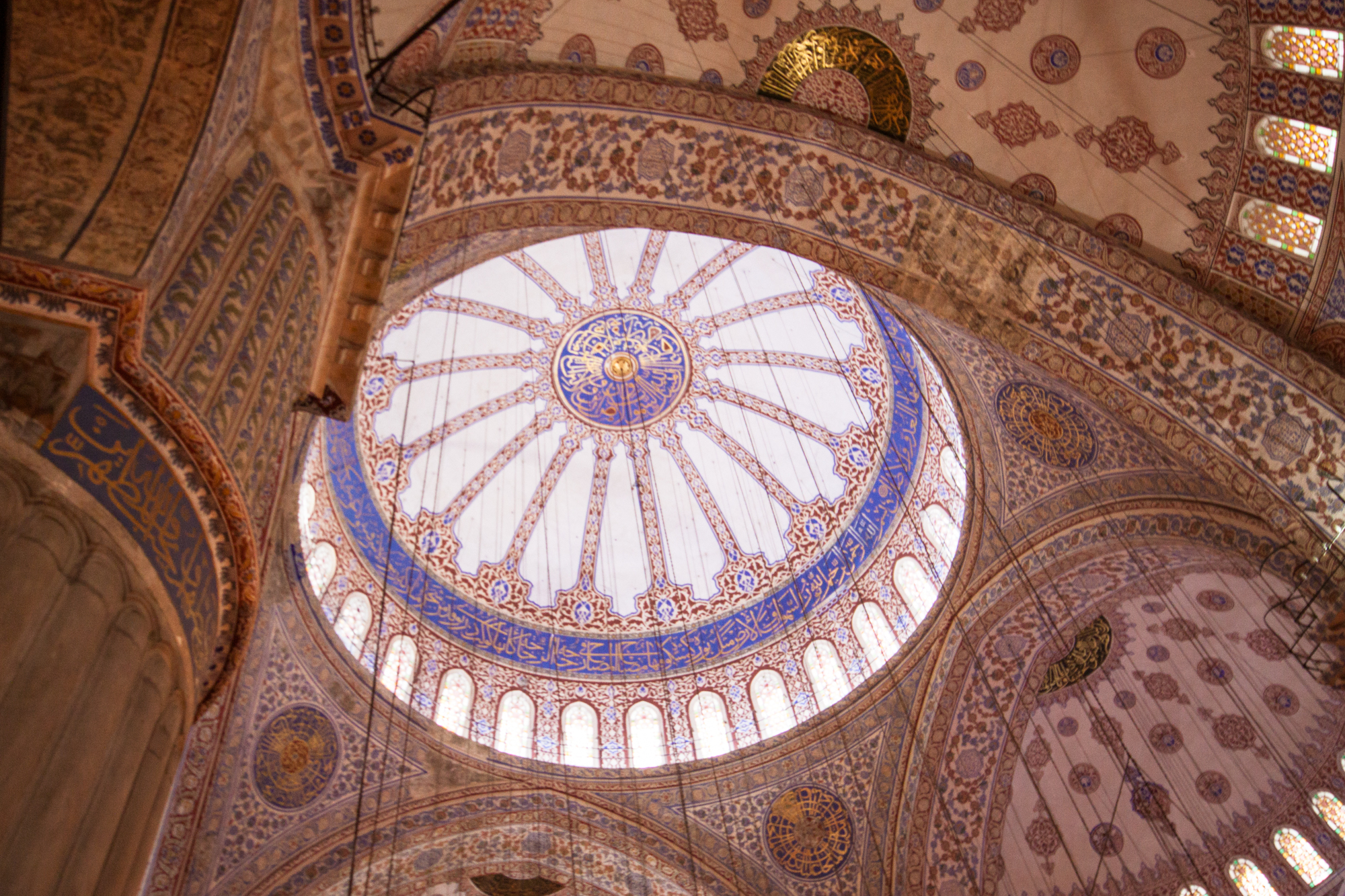 looking up at the dome inside the Blue Mosque