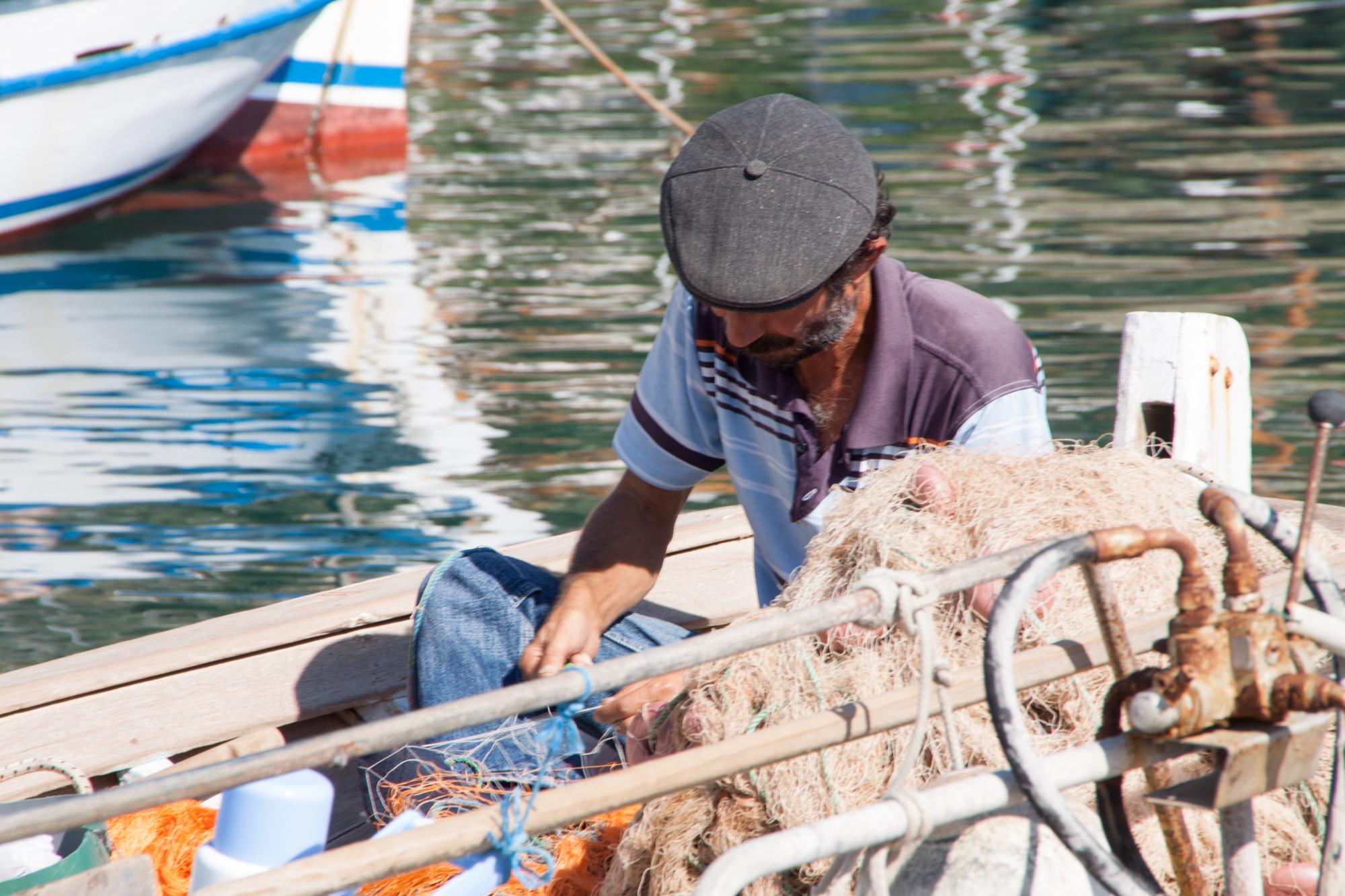 Fisherman mending his net in Anatalya
