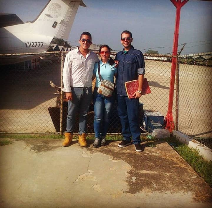 Brandon Proyoto, pictured right with his mother and a friend after he was accepted to flight school in Caracas. (Submitted)
