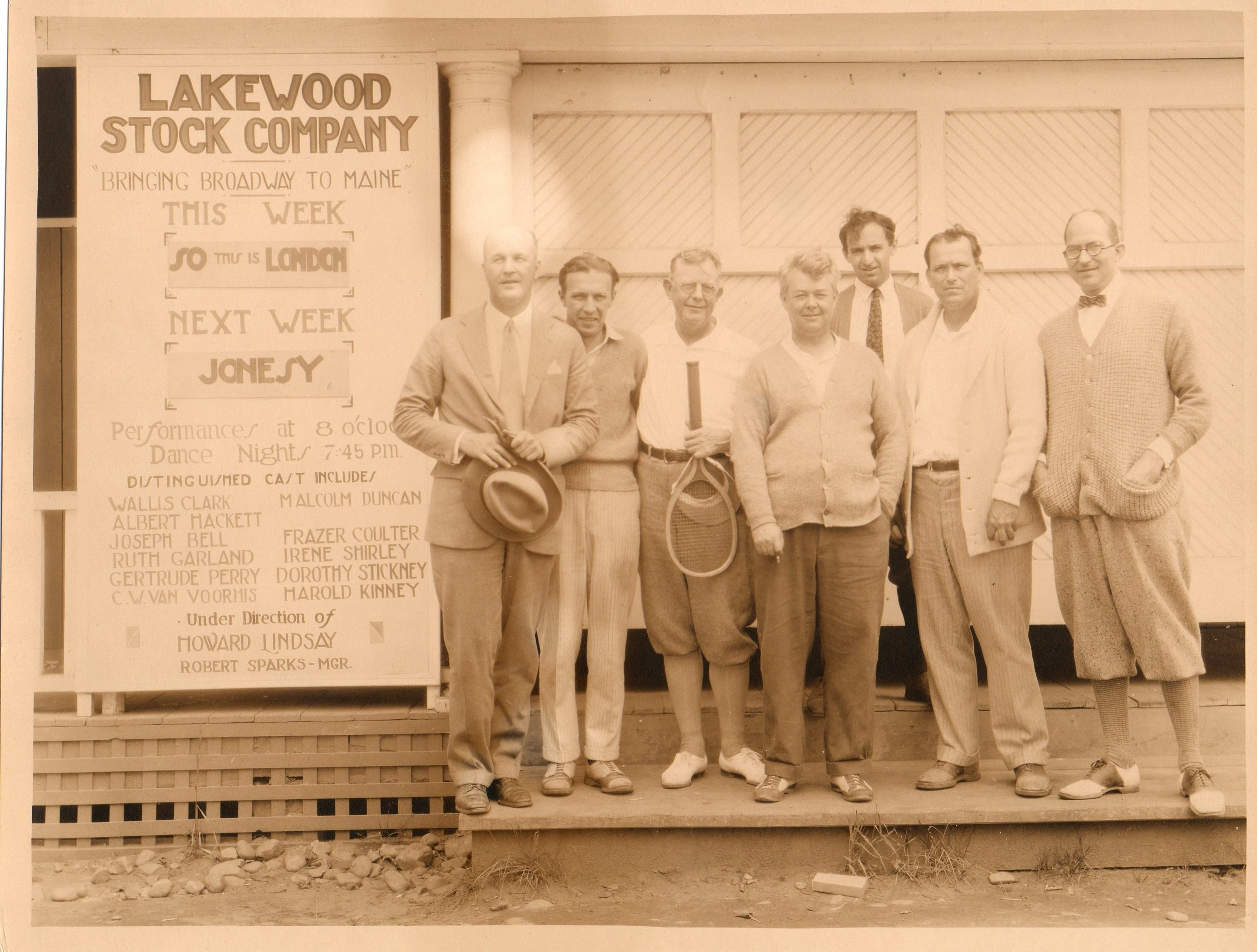 A group of men posing outside of Lakewood Theater 1925