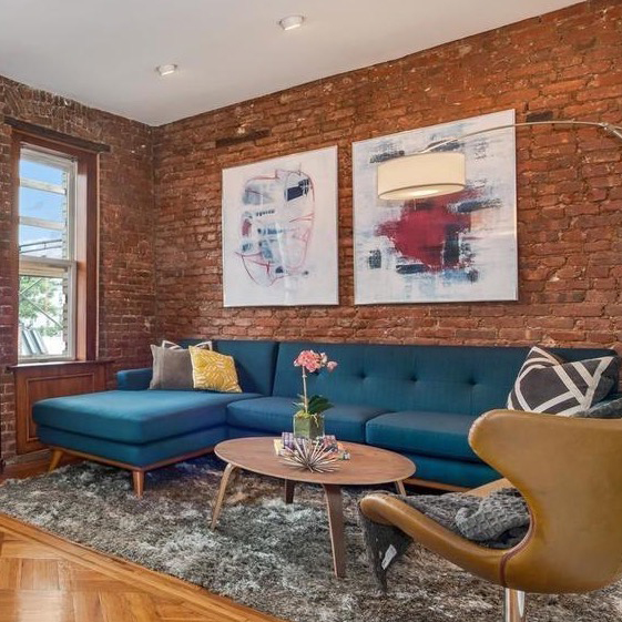 Dunefsky Design enlarged two paintings by Ilana Greenberg and framed them in plexi for the staging of a NYC apartment.