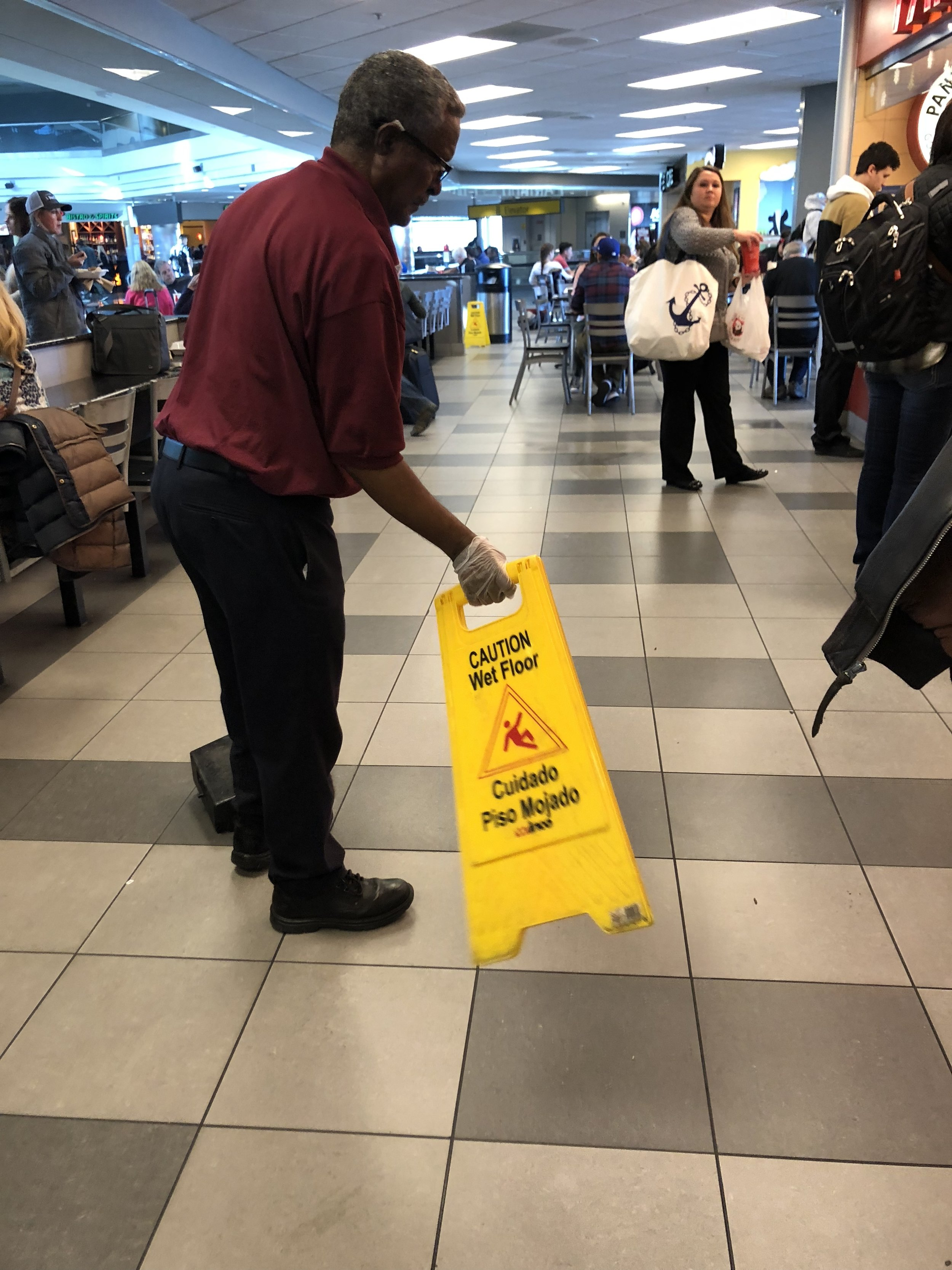 I saw this guy at the airport yesterday, waving the Wet Floor sign to dry the floor – I think these markers have reached their day.