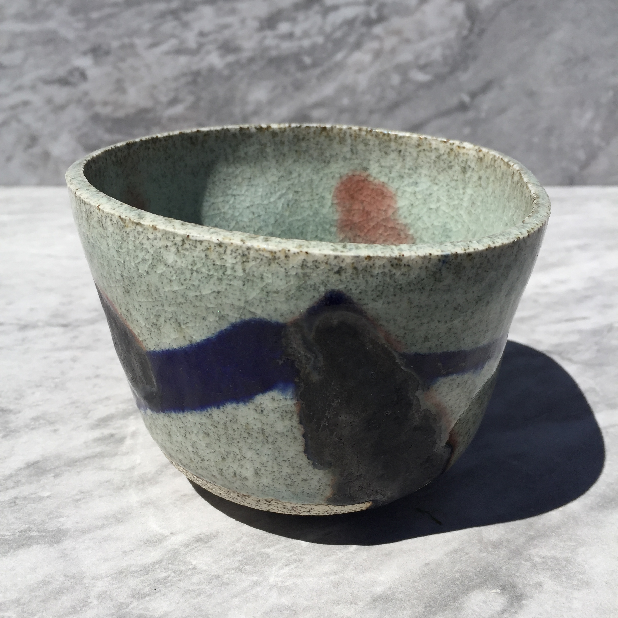 Cobalt and Copper Oxide Celadon tumblers with dimples and Raglan Sand