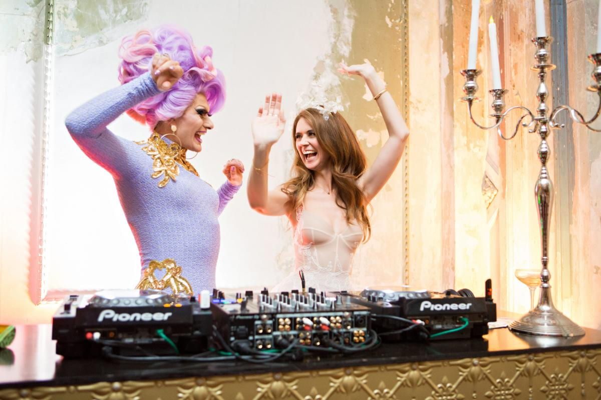 DJ Kitty Glitter with a bride at The George Ballroom, one of Melbourne's most unique wedding venues.