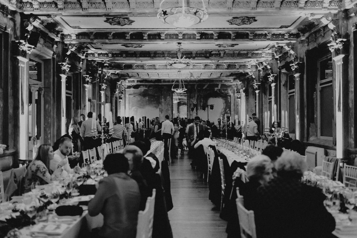 Dining on long tables at The George Ballroom Melbourne.