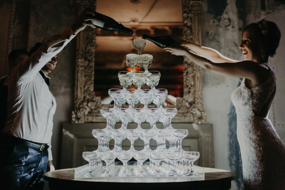 A bridal couple with their champagne tower - Melbourne wedding venues