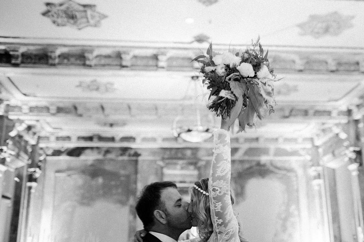 A happily married couple grabs the bouquet at our St Kilda Wedding Venue.