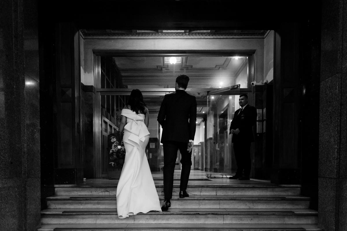 A bride and groom ascend the stairs from Fitzroy St into The George Ballroom Melbourne.