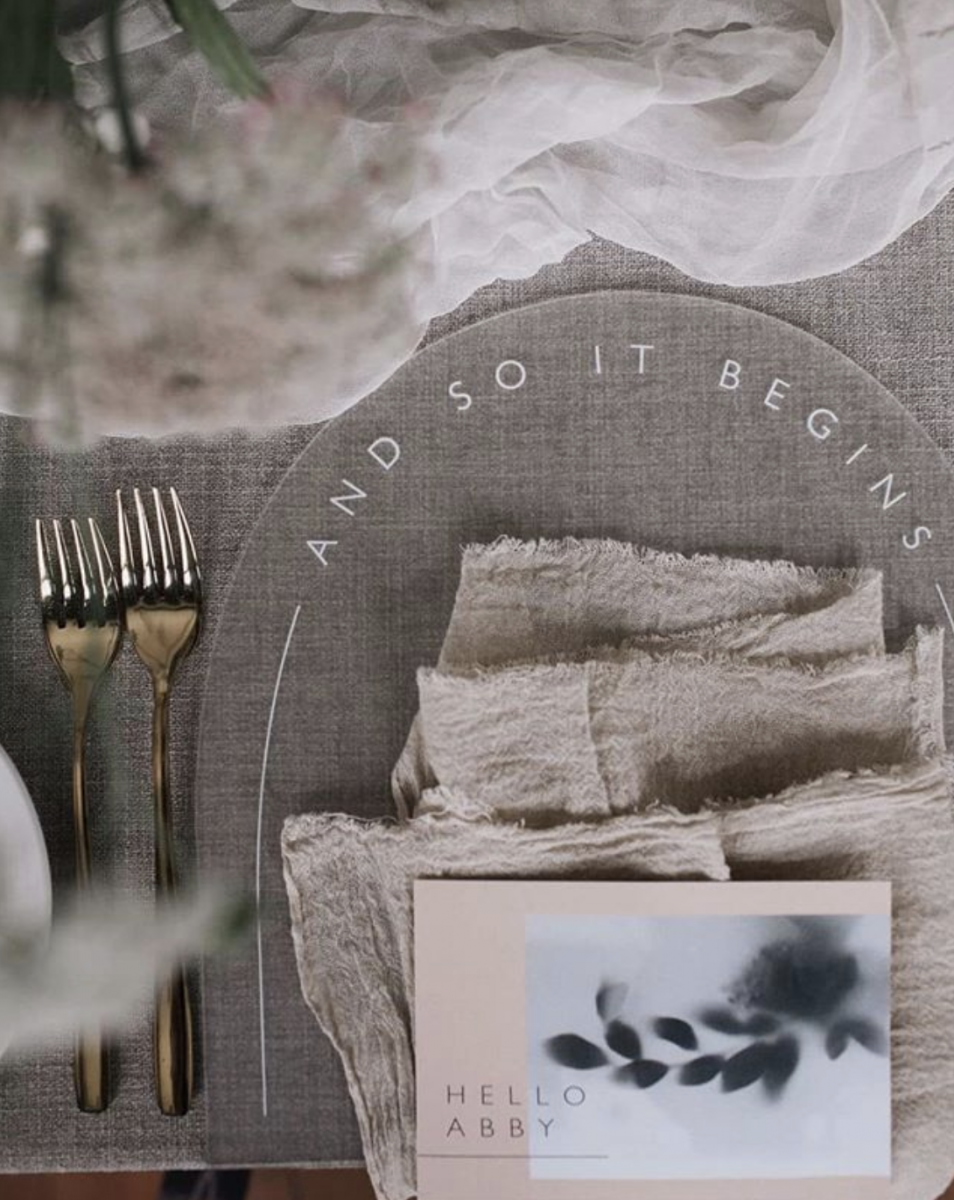 Wedding Dining Setting, featuring a place mat saying 'And so it begins'