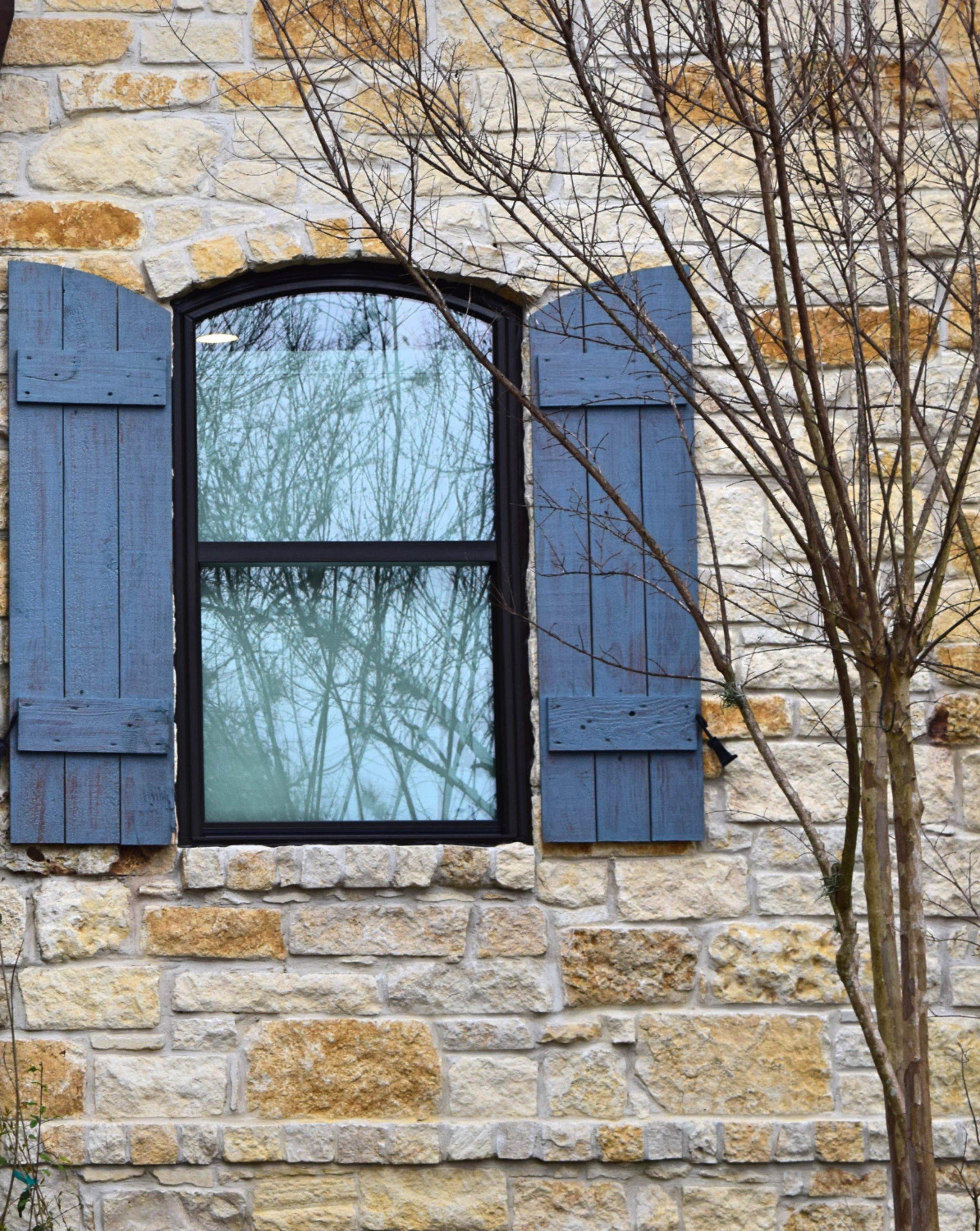 bronze arch shutters.jpg