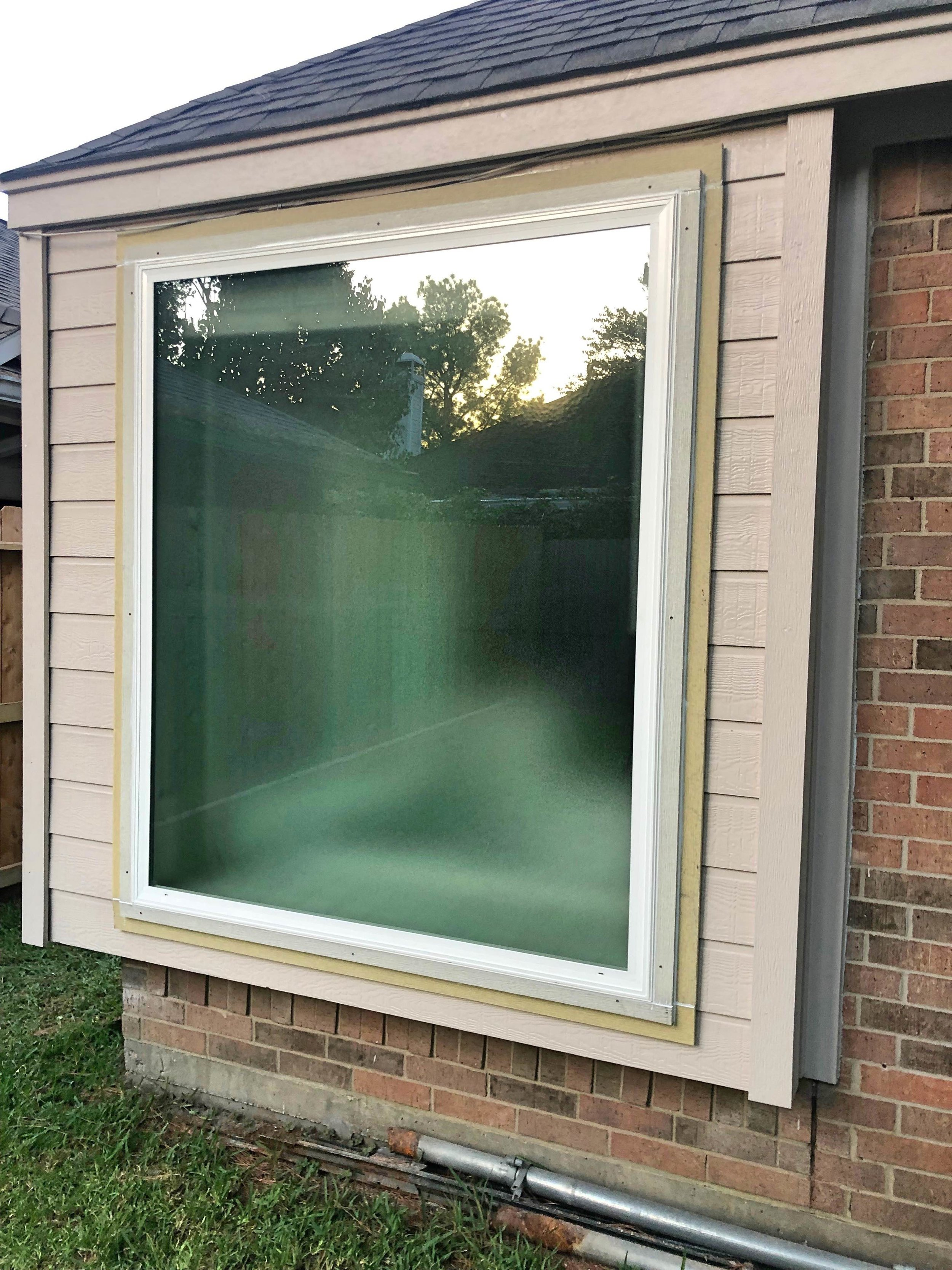 Privacy Windows - These windows are great for bathrooms! They let in light, are energy-efficient, but blur out the inside so you have privacy. You can see the outline of the tub inside to see how it works.