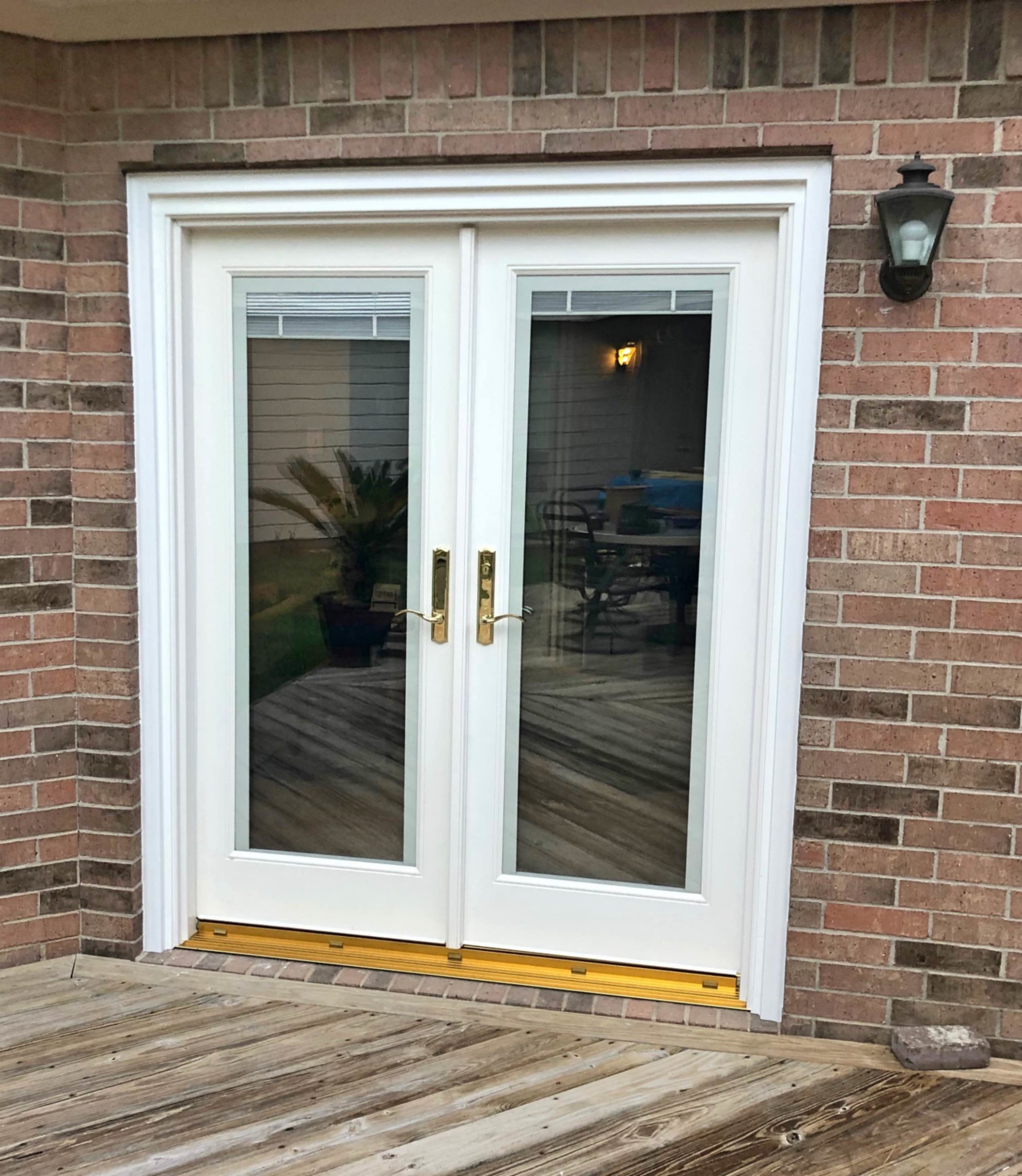 Patio Doors - These Nuema Composite insulated door patio doors are also energy-efficient. There is an option for a double-locking feature. You can also decide if you would like shades on the inside of the glass, and what color door handles you would prefer.