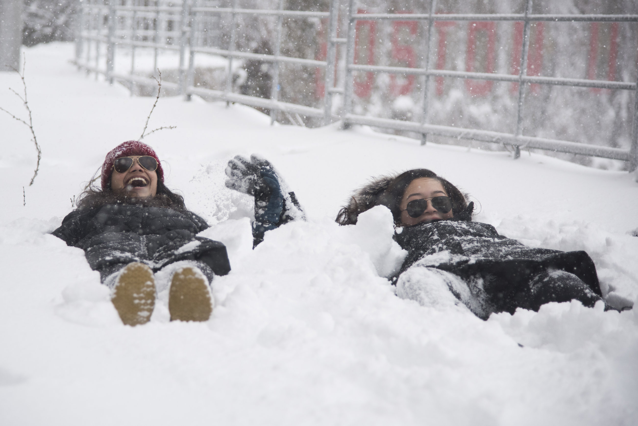 Sachi Mehrota and Tiffany Tong, both freshmen at Boston University, lay in the snow in BU's west campus during New England's third nor'easter in three weeks. The storm brought blizzard-like conditions and the cancellation of classes at BU, other local colleges, and Boston Public Schools.