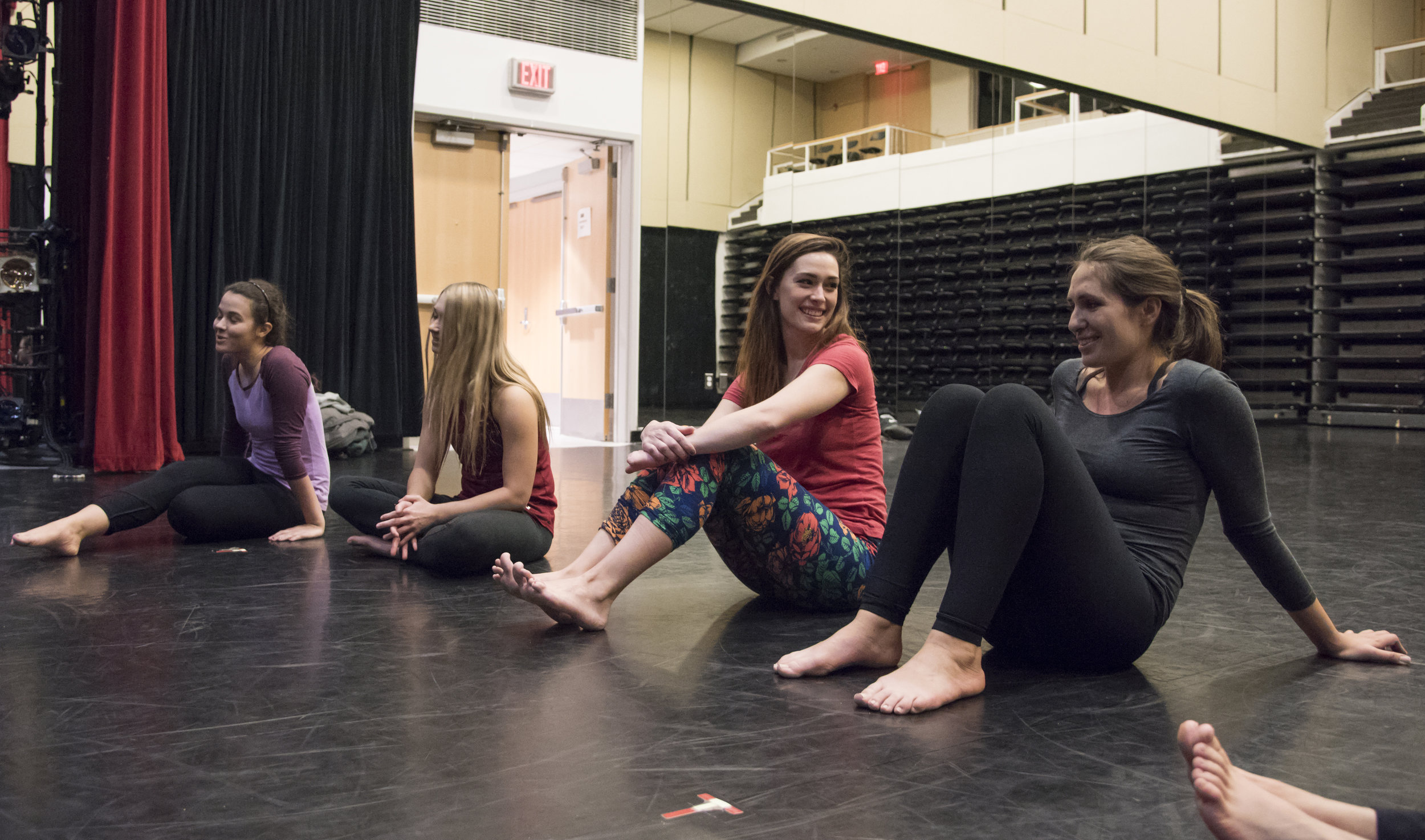 Sarah Tuberty talks to her friend before the start of the weekly aerial dance class she takes at Boston University's Fitness and Recreation Center.
