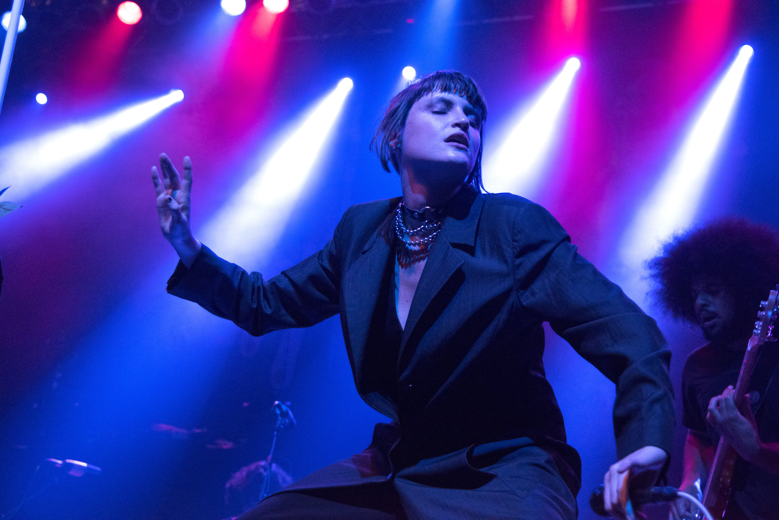 """Katie Gavin, lead singer of the self-described """"dark pop girl band"""" MUNA, dances during their opening set for Grouplove at House of Blues Boston in Fenway November 3rd."""