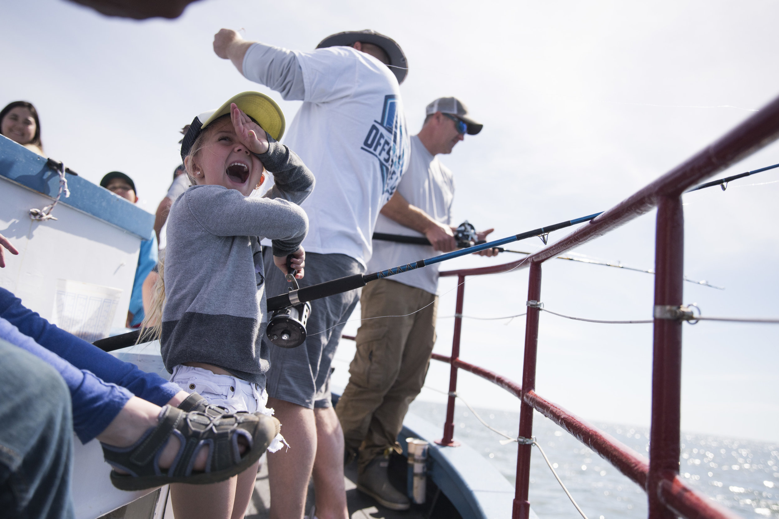 Willow Rosbeck, 5, turns with excitement as her dad unhooks fish she caught aboard the Skipper. Students from the Rainbow Place preschool in Edgartown, MA were treated to a free fishing trip to celebrate their graduation, curtesy of Skipper captain John Potter.